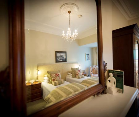 A classic twin room with ensuite